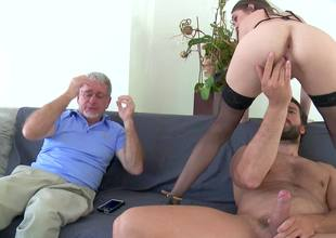 A brunette with tiny tits is getting rammed by a younger dude