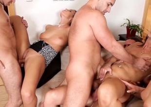 Hot cuties are having an orgy with the men with smiles on their faces