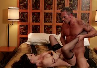 Tattooed porn dude bonks a beautiful black haired escort slut