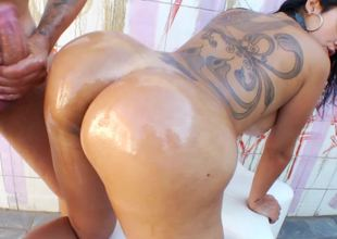 Collared Brazilian girl with a big back tattoo wants anal sex