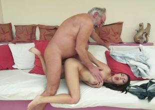 A brunette hair that enjoys attention is getting fucked by an old dude