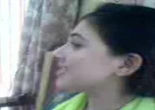 Adorable Pakistani wife kisses her stylish husband