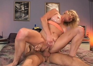 Lustful blonde mom jumps on top of the young guy and passionately rides his cock
