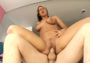 A voluptuous golden-haired honey takes a sticky load of cum to the face