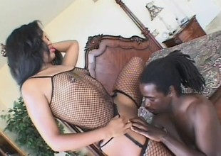 Trashy black babe with a massive butt grinds on her man's dong