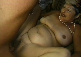 Uninhibited granny is eager to receive drilled hard in doggy style