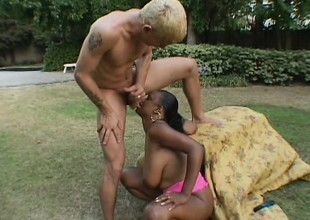 Chubby black broad with a killer rack receives down with a blonde guy