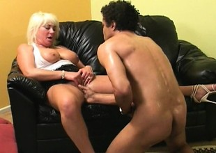 Smokin' hot blonde granny with huge tits takes a big young dick