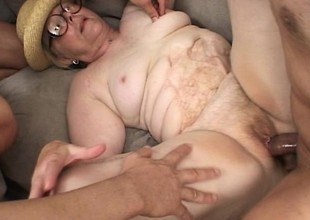 Fat old lady with glasses receives her puggy body group-fucked raw