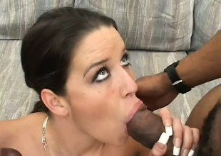 Pretty young brunette sticks a black rod in her face hole while another stretches her cunt
