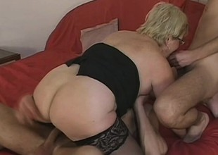 Lusty grandma acquires spit roasted by 2 horny young stallions
