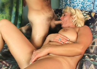 Older blonde loves to have a sausage shoved down her throat