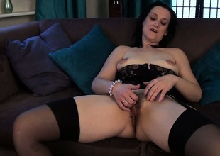 She tries to make her mature body look sexy in lingerie and plays with her hairy hole