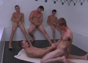 These 5 slutty twinks receives into some hot action in the sauna.  KC & Billy get into some hardcore gazoo fucking while the Rob, Jason adn Dean sit jerking off their cocks as they watch.  KC sits on Billy's cock riding him like a pony until they both shoot their l