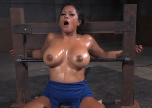 Bound slut with big oiled titties opens for his cock