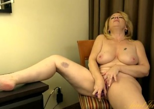Buxom mature babe gets stripped and fucks a toy