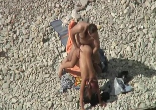 Couple fucking on the beach spied on