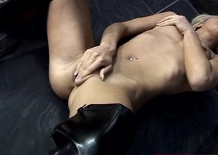 Babe in thigh high leather boots masturbates solo