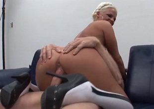 Four guys have fun fucking her pussy and face hole