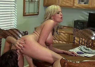 Stormy Daniels and Lily Paige are doing some pussy fingering in this video. They are on the kitchen counter and they are not holding back 'coz of the audience.