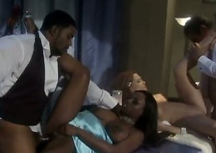 Some mobsters are with a couple of hot women and they are having an orgy. They are into group sex and the sweethearts are getting licking and penetrated in this video.