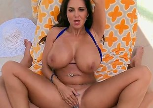 Milf brunette with huge tits is widening her a-hole cheeks so some anal sex could be done. She does not mind being filmed as it is happening.