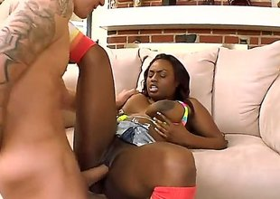 Jada Fire is an ebony babe with huge tits. She is having her pussy licked by a white gut. That guy is also inserting his big shaft inside her wet cunt.