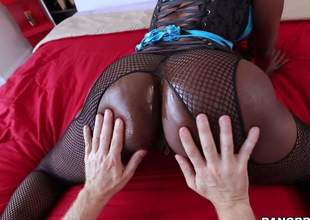 Dark skinned MILF in fishnet pantyhose puts her big black ass on display and then gets ehr throat filled with hard white dick. This babe sucks fortunate guys ivory schlong like a pro!