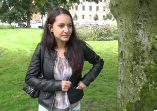 Long haired dilettante dark brown Lili Devil goes topless in a public place for cash. Guy with camera in hand touches her nice natural boobs. Her lovely tanlined breasts turn him on