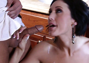 Dylan Ryder has fire in her eyes as she milks cum loaded worm of her gent