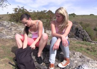 Two hotties go for a hike and eat snatch on a mountain top