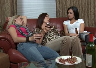 Wine drinking ladies have a hot lesbian trio in bed