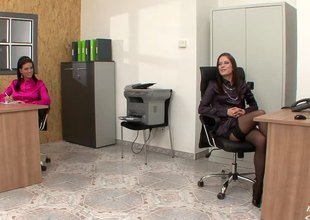 Two babes at the office take up with the tongue pussy and use dildos to cum