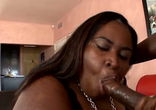 Super huge fat black bitch sucks strong black dick before doggyfuck