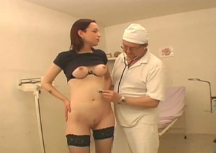 Kinky doctor examines hairless pussy of one young chick Vika wearing hawt stockings