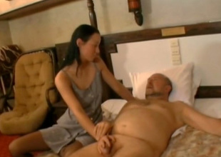Cock crazed coed Irene sucks this old fart's cock like a wild bitch
