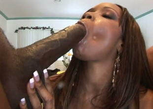 Buxom black chick in knee high boots worships two big cocks like a boss