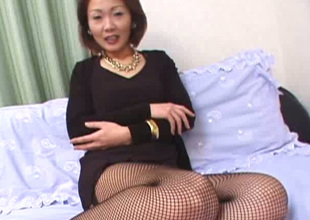 Lewd passionate Japanese MILF in nylons flashes her booty in panties