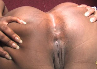 Affectionate ebony chubby with big ass giving huge dick handjob through gloryhole