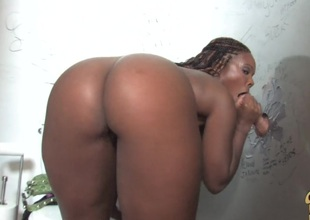 Glamorous ebony with big tits giving big schlong handjob during the time that displaying her black butt