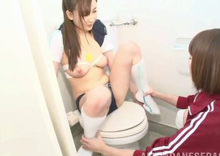 Sporty Asian sub hotty strapon screwed by her coach