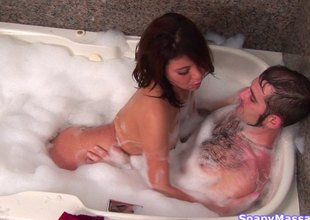 Redhead woman takes a soapy bath and gives a handjob