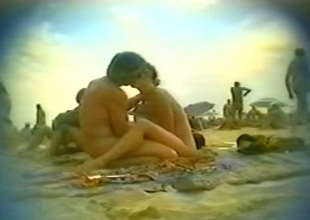 Voyeur sex video with a nasty couple on the beach of Cap d'Agde