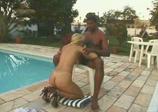 Dashing blonde has her twat licked by the pool before being screwed with a large black cock