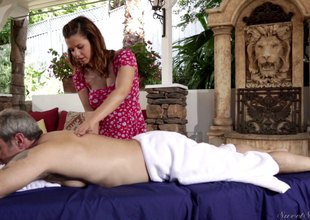 Brunette masseuse gives her beefy client special treatment