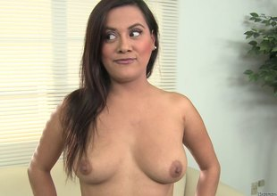Buxom brunette gags on a schlong and takes a facial jizz flow in pov