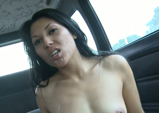 Exotic brunette bitch gets massive cumshot in a car