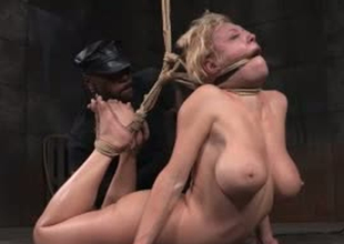 Busty blonde whore is tied up and stretched in S&m porn video