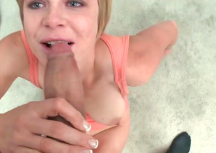 Pretty blonde with blue eyes is sucking a huge dick