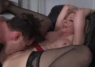 A blonde milf is getting fucked hard by her stepson on the sofa